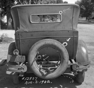 A bullet-riddled getaway car used by chicken thieves.