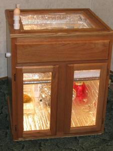Homemade cabinet incubator/hatcher from Backyard Chickens.